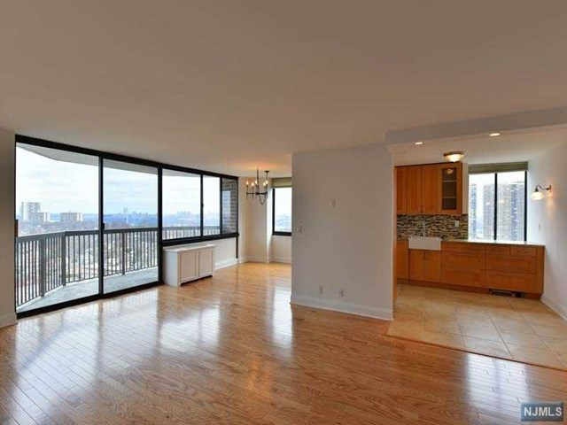 Come home to The GREENHOUSE Tower, Cliffside Park's sought after High Rise residences offering spectacular Hudson River &NYC views from the GWB to midtown. Enter this fully renovated wheel accessible capacious unit, and take in the breath taking views of Manhattan.. With approx. 1200 Sq ft. this unit has it all. The new modern kitchen offers all modern appliances & the breakfast area offers north east views, and the large master suite with the large walk in closet does as well. The2 bedrooms enjoy unobstructed views. The entire hardwood floor has been replaced as were all the doors and the unit freshly painted white. Residents enjoy 24 hour doorman, 2 Parking, porter Service a, gym/ entertainment center/ outdoor pool/sauna. Public transportation right in front of the building with direct shuttles to port authority and the ferry. Conveniently located close to schools, shopping, restaurants and houses of worship.